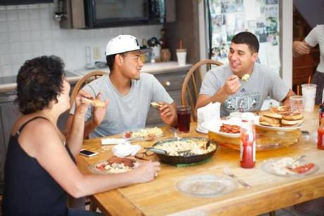 Beth Nessralla, Manny Peguero (center), and C.J. Nessralla ate brunch that they cooked together at C.J.'s Avon home.